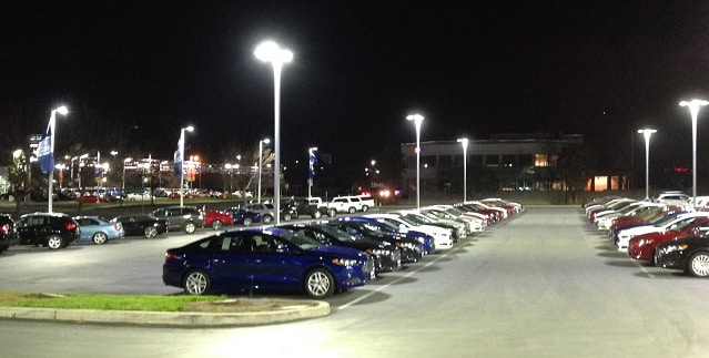 An automotive dealership lot featuring LED lighting